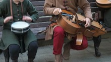 Street Musicians Dressed In Vintage Ethnic Oriental Clothes Play Music On Traditional Middle Eastern Musical Instruments Turkish Darbuka And Hurdy-gurdy