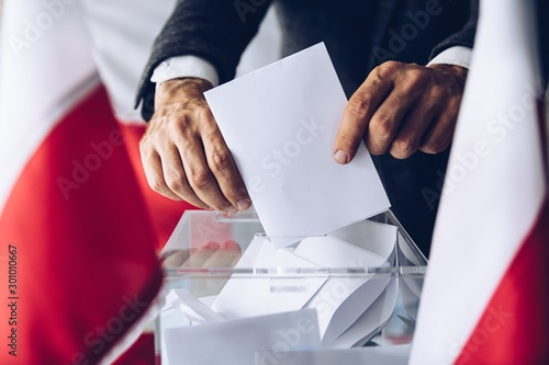 Fotografie, Obraz Man putting his vote do ballot box. Political elections
