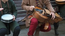 Street Musicians Dressed In Vintage Ethnic Oriental Clothes Play Music On Traditional Middle Eastern Musical Instruments Turkish Darbuka And Hurdy-gurdy And Oud