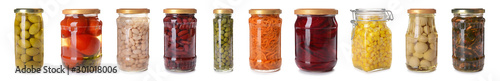 Poster Verse groenten Jars with different canned vegetables on white background