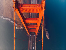 Aerial Top View Of Golden Gate Bridge With Highway, Metropolitan Transportation  Infrastructure, Birds Eye View Of Automobiles And Car Vehicles Moving On Road Of Suspension Construction