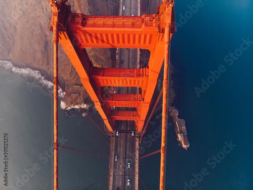 Fotografija Aerial top view of Golden Gate Bridge with highway, metropolitan transportation