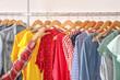 Leinwandbild Motiv Young woman choosing clothes in store