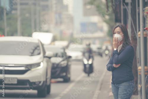 fototapeta na lodówkę woman wearing protective mask in the city street