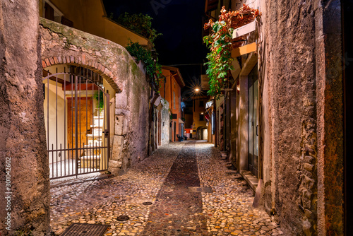 Beautiful old town of Malcesine at night. The town is a popular holiday destination in Garda Lake district. - 301042602