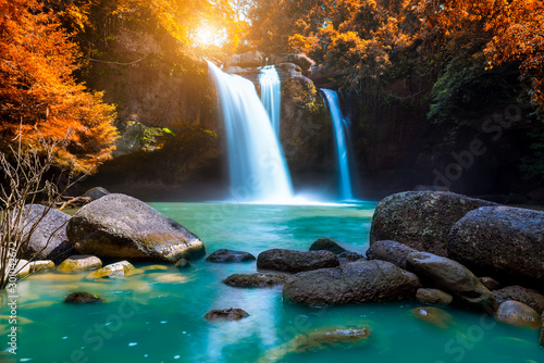 Obraz na plátně The amazing colorful waterfall in autumn forest blue water and colorful rain forest