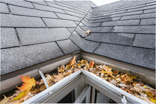 Gutters Are Full Of Fall Leaves And Must Be Cleared