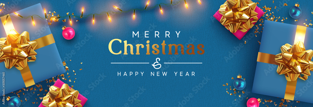 Fototapety, obrazy: Holiday banner Merry Christmas and Happy New Year. Xmas design with realistic festive objects, blue gift box, lilac ball, light lamps garland, glitter gold confetti. Horizontal poster, flat top view