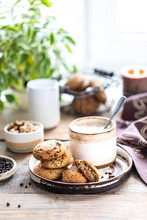 Homemade Cookies With Nuts And Coffee In A Ceramic Cup