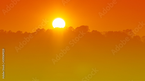 A warm tone view of a sunset. Slika na platnu