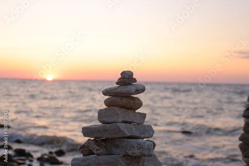 Poster de jardin Zen pierres a sable beautiful sunrise by the sea, flora and fauna of ocean life, background water and sunset romantic mood