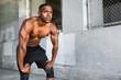 Leinwanddruck Bild - Lifestyle of african american athlete preparing for run, jogging, intense conviction, determination, serious stare, powerful eyes