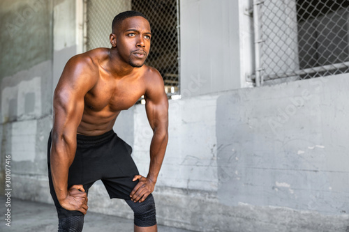 Lifestyle of african american athlete preparing for run, jogging, intense convic Canvas Print
