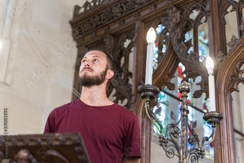 Stampa su Tela Young boy in front of a lectern in a church