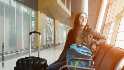 Fotografie, Obraz  Passenger traveler woman in airport waiting for air travel and looking window, s