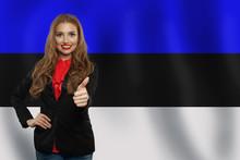 Estonia. Happy Girl Showing Thumb Up And Smiling On Estonian Fla