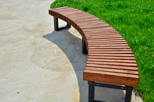 Curved Wooden Bench In The Par...