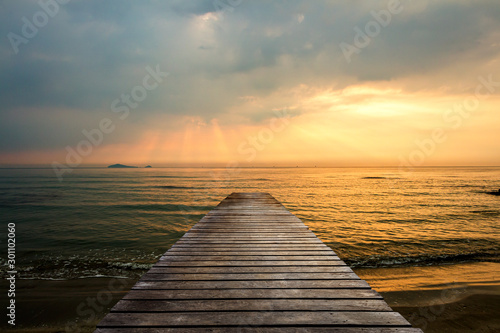 Golden sea sunset view of pier or jetty in the tropical in the summer Wallpaper Mural