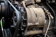 Old Serpentine Drive Belt For Motor On Alternator Pulley On Automobile Engine,Tractor Engine Alternator With V-belt Pulleys Transmission Close Up.