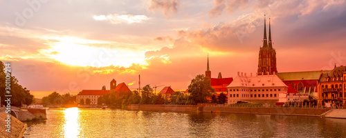 Poster Corail Wroclaw, Poland sunset panoramic banner with Ostrow Tumski island, Odra or Oder river and cathedral towers