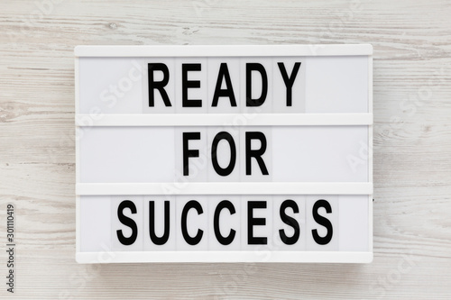 Fototapety, obrazy: 'Ready for success' words on a modern board on a white wooden background. Overhead, from above, flat lay.