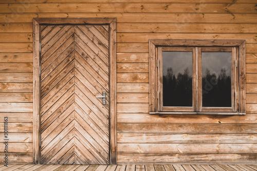 Photographie Door and window of wooden house