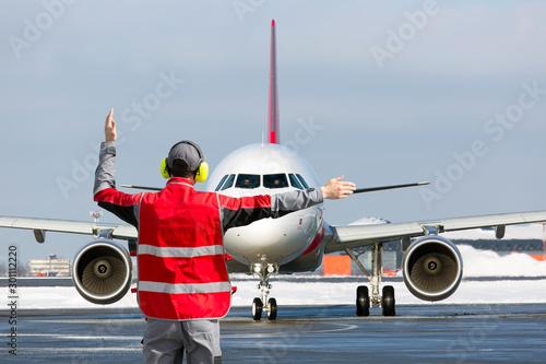 Photo Aviation Marshall / Supervisor meets passenger airplane at the airport