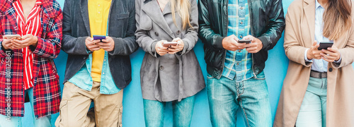 Photo Group of friends using smart mobile phones app - Teenagers addiction to new tech