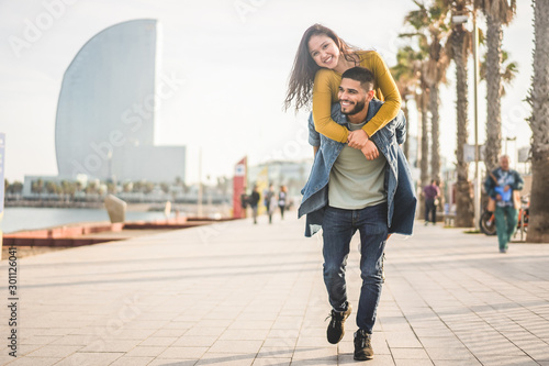 Happy couple having fun walking in Barcelona - Young people enjoying time togeth Wallpaper Mural