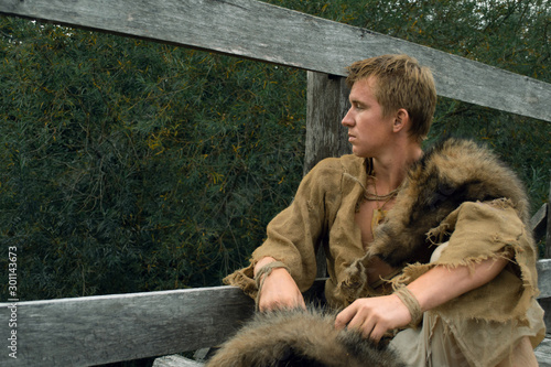 Downshifting concept - medieval peasant in a ragged clothes reconstruction Canvas Print