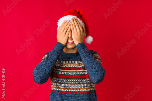 Fotografie, Obraz  Young man on christmas day keeping two arms crossed, denial concept