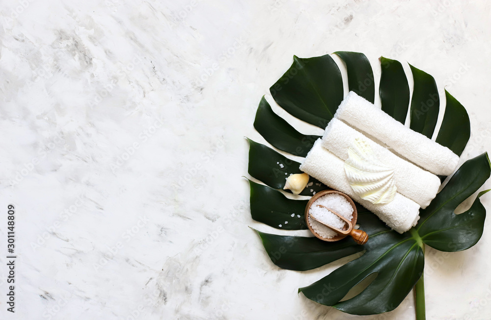 Fototapety, obrazy: Spa massage products with monstera leaves on marble background