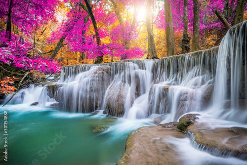 Fotografía  Amazing in nature, beautiful waterfall at colorful autumn forest in fall season