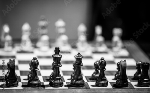 Monochrome shallow depth of field (selective focus) image with wooden chess pieces on a wooden table before a professional competition Tapéta, Fotótapéta