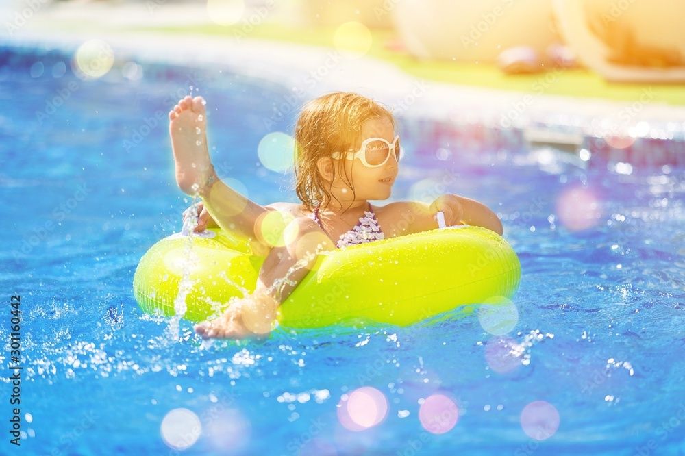 Fototapety, obrazy: Children playing in pool. Two little girls having fun in the pool. Summer holidays and vacation concept