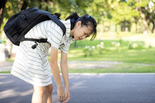 Stress Asian Child Girl Carrying Heavy School Bag Or Backpack, Female Teenage Feeling Pain On Back, Full Of Books On Her Back, Going To School For The First Time, Tired Student Back To School Learning