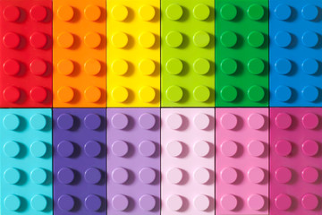 Many toy blocks in different colors making up one large square shape in top v...