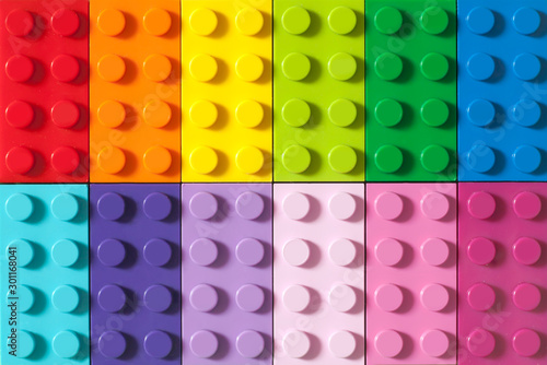 Fotografia, Obraz Many toy blocks in different colors making up one large square shape in top view