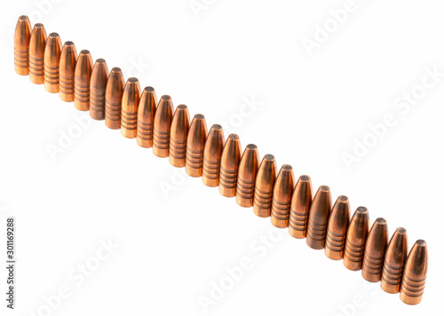 Fototapeta  Expansive bullets with a copper shell and lead inside, 9 mm caliber, stand in a row, on a white background