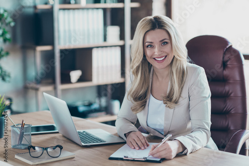 Fotografie, Obraz  Photo of amazing blond business lady notebook table signing contract important p
