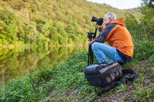Fototapeta Nature photographer in landscape photography as a hobby obraz