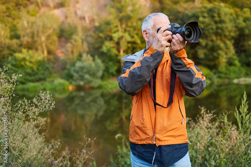 фотография Landscape photographer in nature while photographing