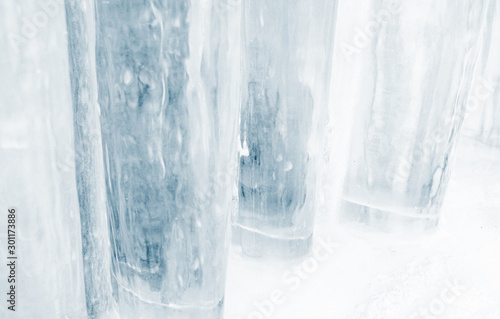Fényképezés  Thick pillars of blue ice recede into the background making an abstract pattern