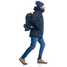 Man In Winter Jacket And Warm Hat, With Backpack Walking Goes