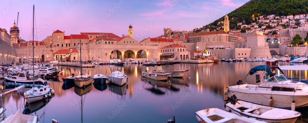 Fototapety, obrazy: Panoramic view of Old Harbour with boats and Old Town of Dubrovnik at sunset, Croatia