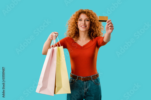 Keuken foto achterwand Dinosaurs happy girl holding shopping bags and credit card, Isolated On blue