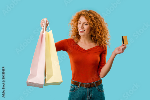 Keuken foto achterwand Dinosaurs beautiful girl holding shopping bags and credit card, Isolated On blue