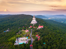 Top View Aerial Photo From Flying Drone.Big Buddha Wat Phu Manorom Mukdahan Thailand.Buddha On The Mountain.