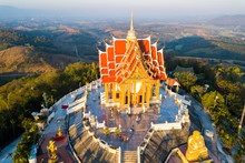 Top View Aerial Photo From Flying Drone.The Beautiful  Of Thai Temple (Wat Pa Phu Hai Long) On The Top Of Mountain  In Pak Chong District,Nakorn Ratchasima, Thailand.
