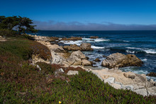 Waves Crashing On Rocks At Pacific Grove, California